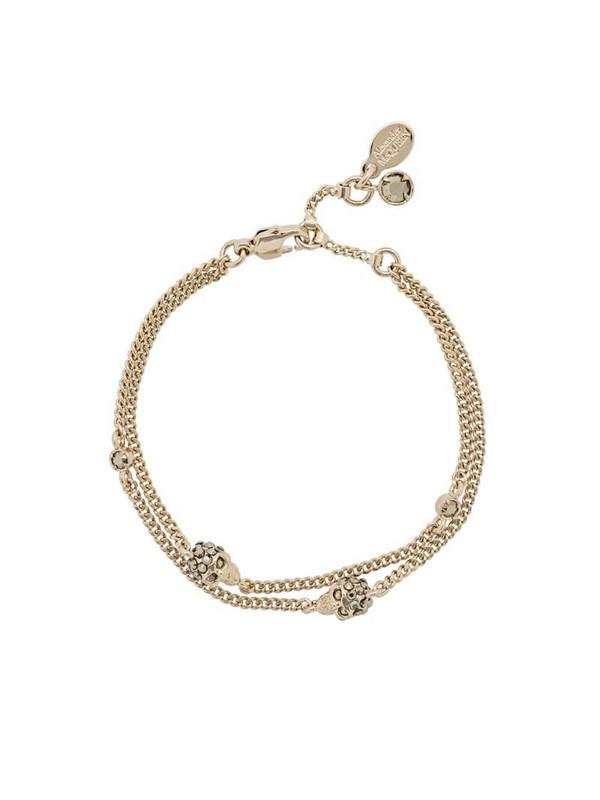 Alexander McQueen skulls bracelet in gold