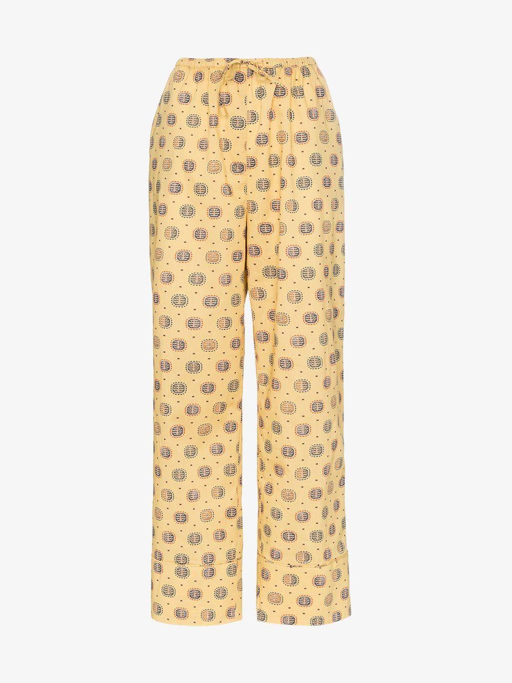 Toteme Natal printed drawstring trousers in yellow / print