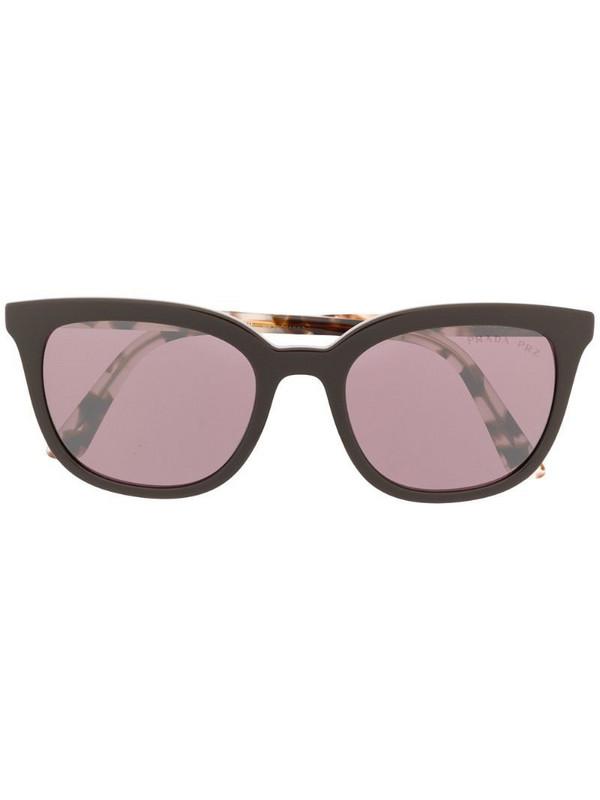 Prada Eyewear cat-eye frame sunglasses in brown