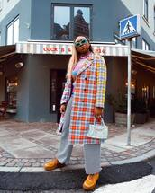 coat,long coat,plaid,multicolor,double breasted,mustard,lace up boots,wide-leg pants,houndstooth,black and white,white bag,handbag,turtleneck sweater,striped sweater