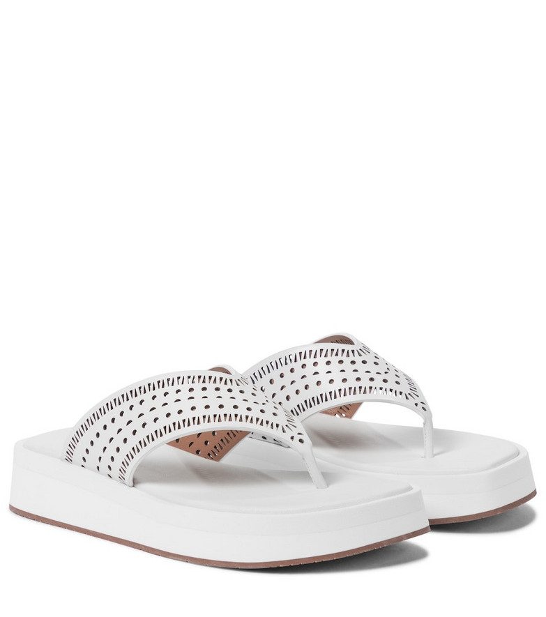 Alaïa Laser-cut leather thong sandals in white