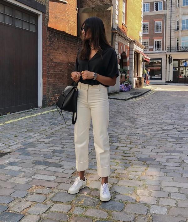 top black shirt short sleeve high waisted pants sneakers black bag