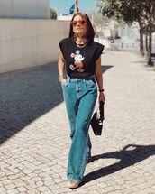 top,black t-shirt,wide-leg pants,high waisted jeans,black bag