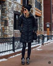 jacket,long jacket,puffer jacket,black boots,lace up boots,black leggings,black bag,knit,hat,winter outfits,winter boots