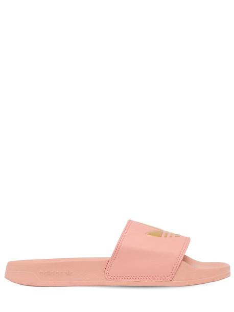 ADIDAS ORIGINALS Adilette Slide Sandals in gold / pink