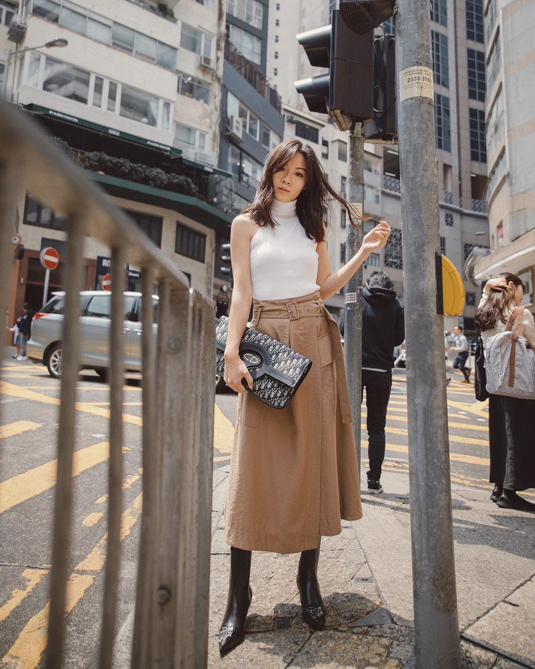 skirt midi skirt wrap skirt black boots knee high boots dior bag white top turtleneck