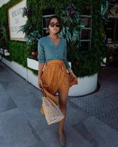 skirt,wrap skirt,orange,white bag,shoes,crop tops,off the shoulder top,cardigan