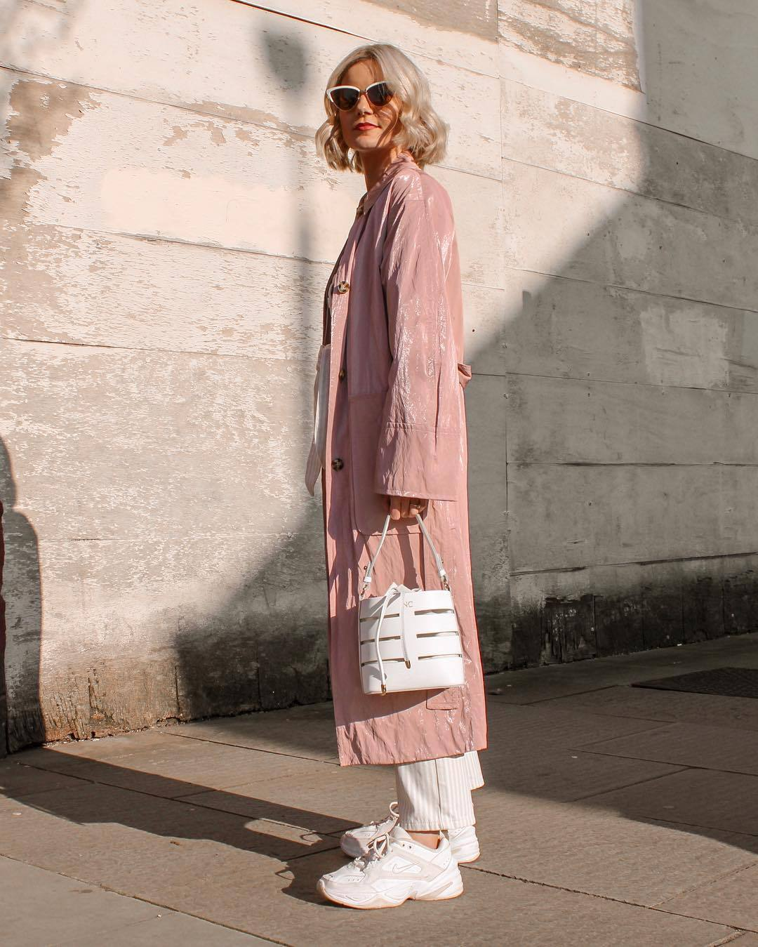 bag white bag white sneakers long coat pink coat straight pants striped pants