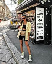 bag,belt bag,sneakers,blazer,black shorts,black top