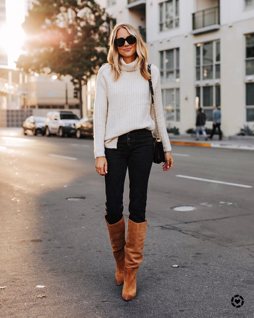 sweater white sweater turtleneck sweater knee high boots brown boots black skinny jeans black bag