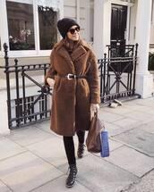 coat,teddy bear coat,black boots,lace up boots,black leggings,black belt,brown bag,black beanie