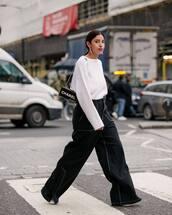 sweater,white sweater,high waisted pants,black pants,wide-leg pants,white boots,chanel bag,black bag