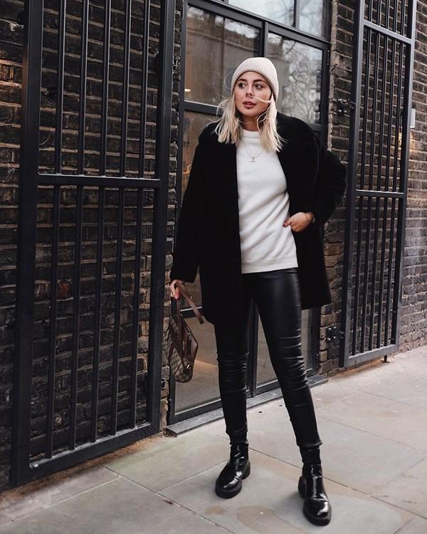 sweater white sweater black boots black leather pants black coat beanie bag