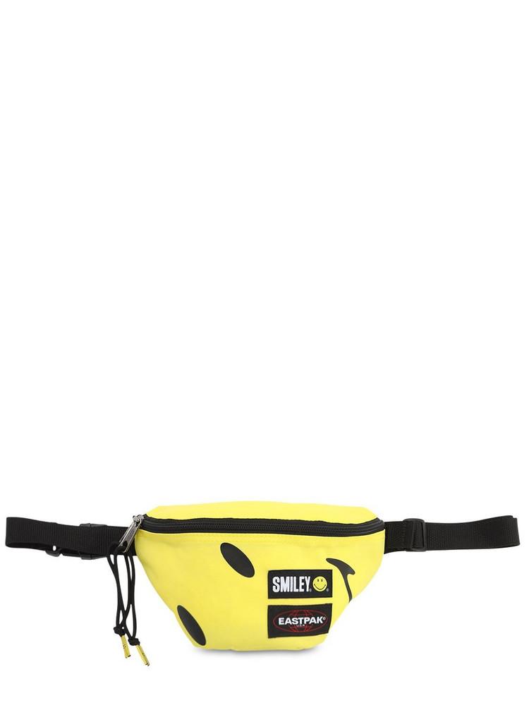 EASTPAK Springer Smiley Belt Bag in yellow