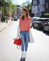 jeans,ripped jeans,white boots,cowboy boots,red bag,white coat,striped shirt,headband