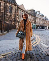 coat,long coat,faux fur coat,knee high boots,cropped jeans,straight jeans,black bag,black turtleneck top