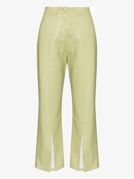 Matériel Cropped flared faux leather trousers in green
