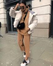 jacket,puffer jacket,white jacket,white sneakers,tracksuit,brown,prada bag,black bag