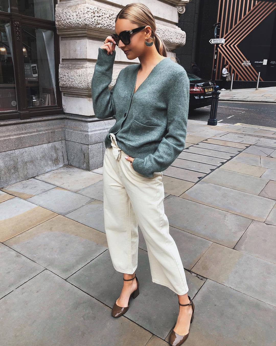 sweater cardigan wide-leg pants white pants sandals sunglasses
