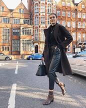 pants,black pants,snake print,brown boots,ankle boots,high waisted pants,leather pants,black bag,shoulder bag,brown coat,black sweater
