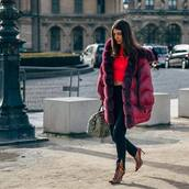 pants,black pants,skinny pants,slit pants,ankle boots,heel boots,lace up boots,handbag,puffer jacket,red jacket,crop tops,red top
