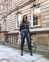 pants,black leather pants,straight pants,black boots,patent boots,ankle boots,black sweater,stripes,black sunglasses