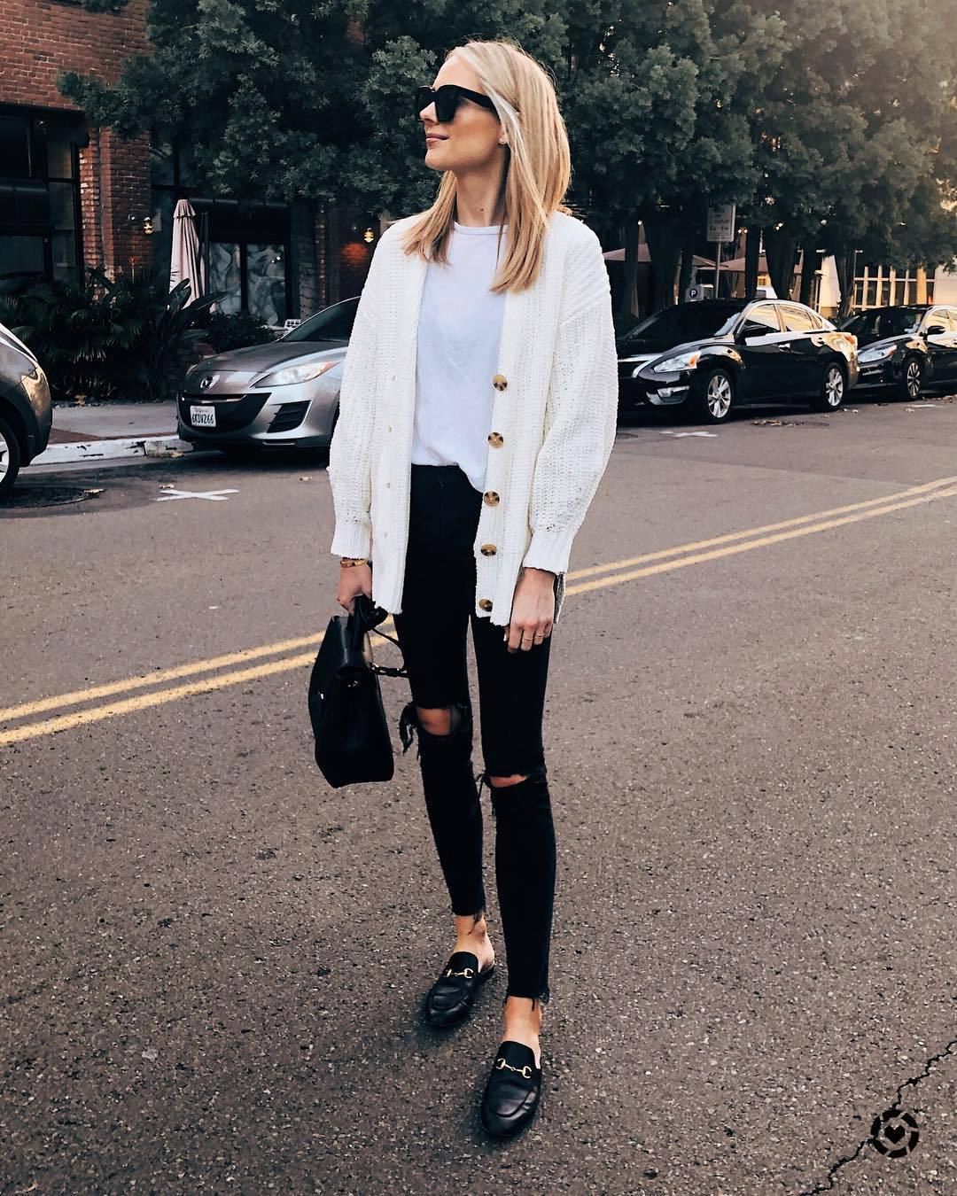 sweater cardigan mules black loafers black skinny jeans black ripped jeans black bag white t-shirt black sunglasses