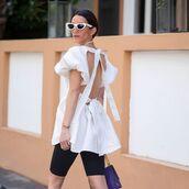 top,white blouse,open back,black shorts,bag