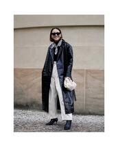 coat,trench coat,black coat,long coat,black boots,wide-leg pants,white pants,high waisted pants,white bag,handbag,black turtleneck top,scarf,black sunglasses