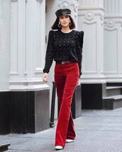 sweater,knitted sweater,embellished,black sweater,flare pants,white boots,gucci belt,earrings,beret