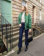 jacket,bomber jacket,green jacket,h&m,turtleneck sweater,grey sweater,black boots,flare jeans,high waisted jeans,black bag