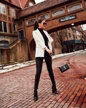 jacket,white blazer,black boots,sock boots,black skinny jeans,black bag,ysl bag,black turtleneck top