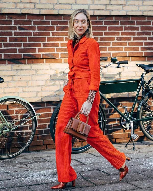 jumpsuit heel boots snake print leopard print turtleneck brown bag handbag leather bag