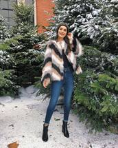 coat,faux fur coat,chevron,black boots,heel boots,ankle boots,skinny jeans,black top,long sleeves,knit,hat