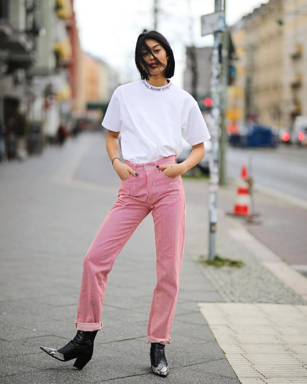 top white t-shirt acne studios black boots cowboy boots pink pants straight pants high waisted pants