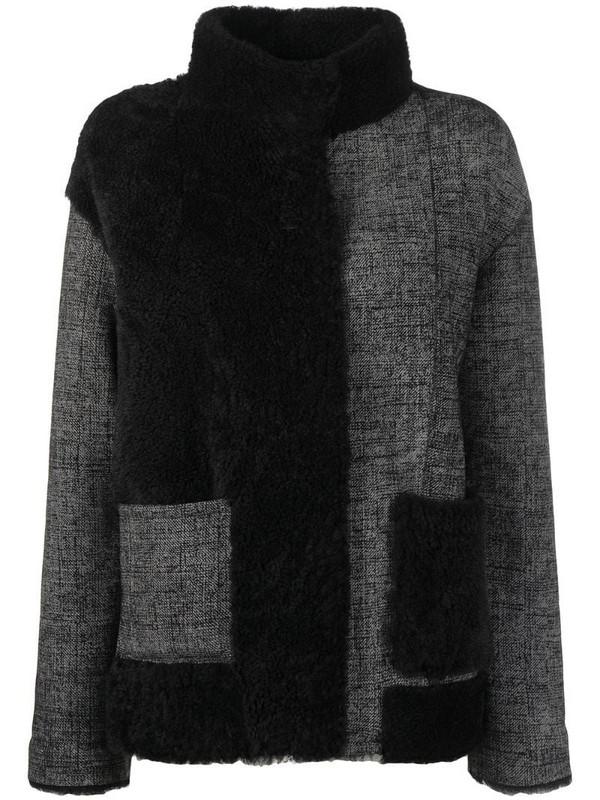 Suprema panelled shearling jacket in black