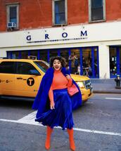 colormecourtney,blogger,coat,skirt,tights,bag,shoes,sweater,red boots,pleated skirt,wonder woman,blue skirt,faux fur coat,blue coat