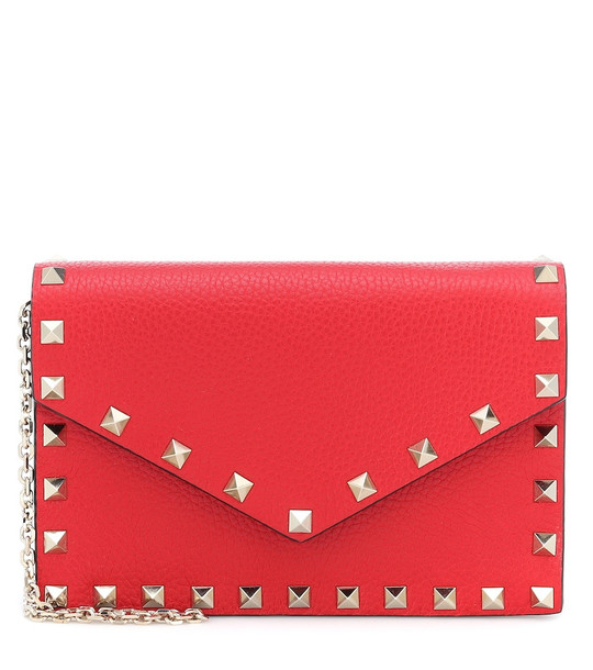 Valentino Garavani Rockstud Small leather clutch in red