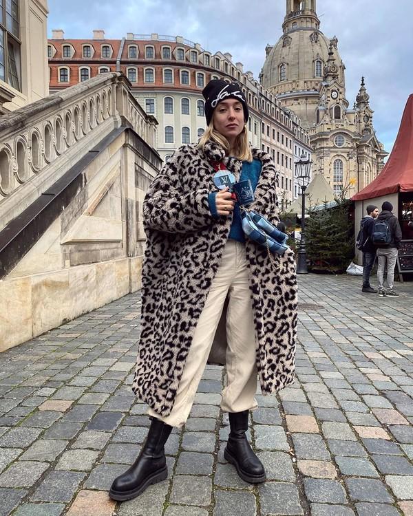 coat faux fur coat leopard print black boots pants sweater beanie