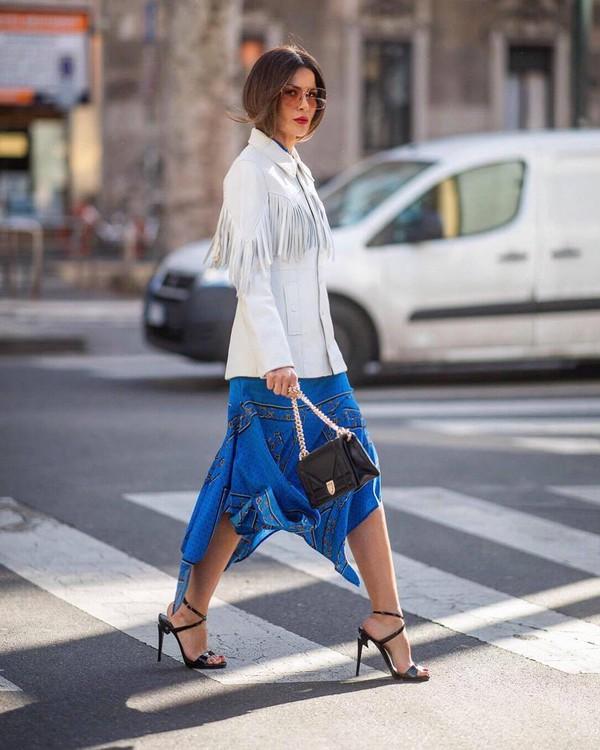 jacket leather jacket white jacket fringes black sandals black bag midi skirt asymmetrical skirt blue skirt