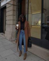 coat,long coat,brown coat,heel boots,straight jeans,black top,black bag