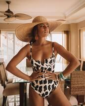 swimwear,leopard print,one piece swimsuit,hat,earrings