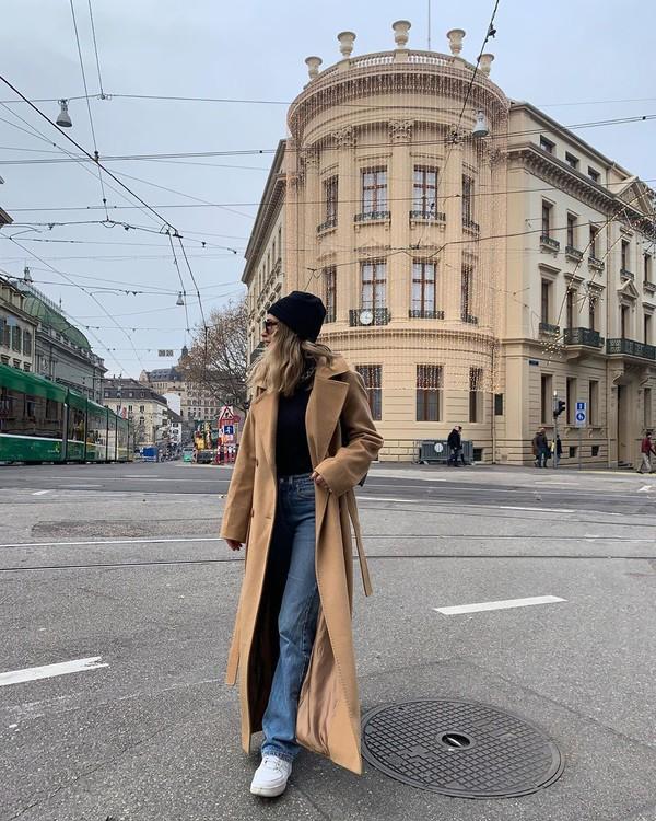 coat long coat flare jeans sneakers black turtleneck top beanie