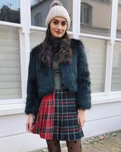 coat,faux fur coat,green coat,tights,pleated skirt,mini skirt,plaid skirt,turtleneck,beanie
