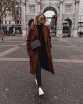 coat,oversized coat,double breasted,brown coat,long cardigan,white sneakers,black skinny jeans,black bag,black sweater,turtleneck sweater