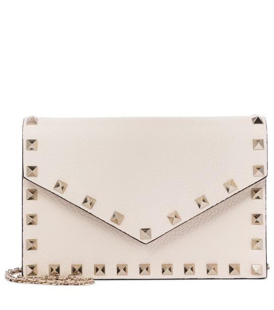 Valentino Garavani Rockstud Small leather clutch in white