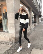 sweater,turtleneck sweater,stripes,black leggings,leather leggings,white sneakers