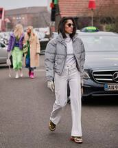 jacket,puffer jacket,grey coat,sneakers,wide-leg pants,leather pants,white pants,high waisted pants,leather gloves,sequins,handbag,white turtleneck top