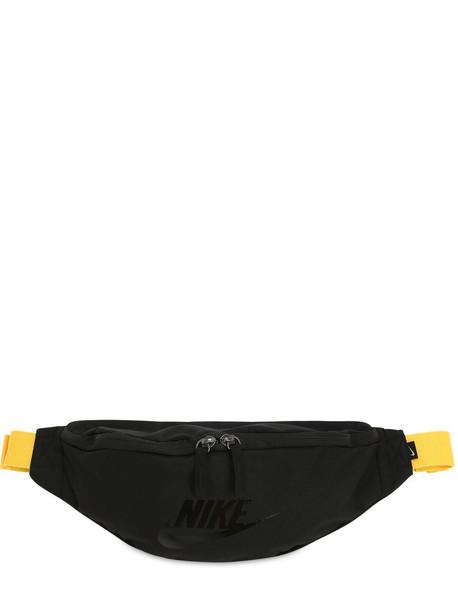 NIKE Sportswear Heritage Techno Belt Bag in black / yellow