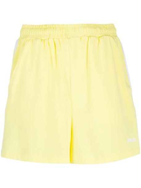 Fila side striped shorts in yellow